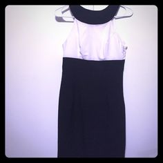 Halter style classy black and white dress in S Stay classy and sophisticated while being sexy with this halter line dress in black and white. The dress will surely hug your curves while channeling your inner Audrey Hepburn.  Forever 21 Dresses