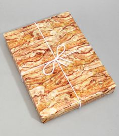 Wow. Bacon wrapping paper. http://www.fredflare.com/AT-HOME-stationery/Bacon-Lovers-Gift-Wrap/