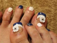 white and blue toenails with flowers