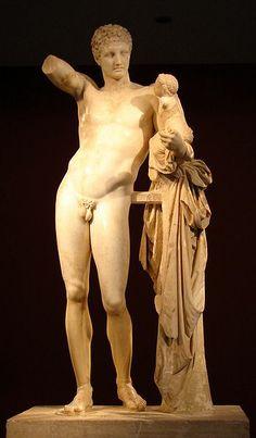 Hermes con el niño Dioniso: Praxíteles.  Hermes con el niño Dioniso es una escultura griega de mármol con una altura de 213 centímetros que se encuentra en el Museo Arqueológico de Olimpia.