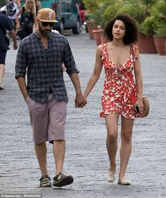 Nathalie Emmanuel was spotted putting on a cosy display once again with her fellow actor Alex Lanipekun at the Ischia Film Festival, and she oozed summer chic in a red floral dress - fashion Afro, Winter Outfits, Casual Outfits, Nathalie Emmanuel, Red Floral Dress, Famous Couples, Star Wars, Summer Chic, Belle