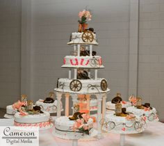 Country-themed cake with cowboy hats, boots and wagon wheel!