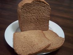 Whole Wheat Bread (Bread Machine) BEST whole wheat bread ever! I tweaked a bit though and used of almond milk and cup water instead of milk powder. Also used more honey in place of the molasses. This was so tasty! Whole Wheat Bread Machine Recipe, Best Whole Wheat Bread, Best Bread Machine, Bread Maker Machine, Breadmaker Bread Recipes, Bread Machine Recipes Healthy, Bread Maker Recipes, Healthy Milk, Bread Packaging