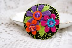 BLACK felt pin brooch with bright and colorful flowers and embroidery. $13.00, via Etsy.