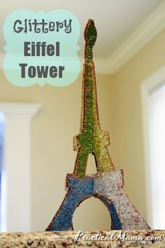 Glittery cardboard stand up Eiffel Tower that kids can make. Love it!