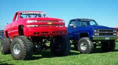 Monster red Chevrolet Silverado and lifted blue Chev trucks