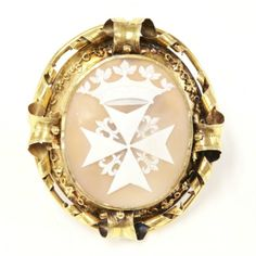 Victorian Gold Mounted Carved Shell Cameo Pendant, The Oval Carved Shell Cameo In  White To A Tan Ground, Depicting The Order Of St. John With Ducal Coronet Above, Rub Set To A Frame With A Tubular Border, Large Engraved Paper Scrolls At The Compass Points With Trailing Ivy Between, Mounted In 18k Gold   c.1850