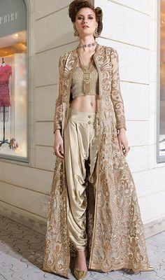 Win hearts of thy bystanders dressed in this beige color embroidered bhagalpuri silk, net dhoti style suit. This charming attire is displaying some terrific embroidery done with resham and stones work. #StylishtBeigeSilkNetDhotiStyleDress