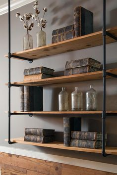 Complement rustic shiplap with industrial elements, like this sculptural shelving unit made from plumbing pipe and pine planks.