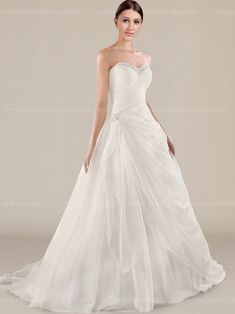Strapless destination wedding gown features in chiffon. Gently pleated bodice accents beaded sweetheart neckline. Full length A-line skirt with gorgeous side draping. Lace up back, chapel train, fully lined.