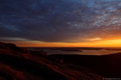 Bar Harbor Sunrise: The sun rises over Bar Harbor on Mount Desert Island. This shooting location is a short hike from the top of Cadillac Mountain. A note: I rarely shoot at f/14 (especially with a tilt-shift lens) and did not need to go this narrow for this photograph. I was bracketing exposures and mistakenly went to f/14. For more images with commentary visit us at www.The-Digital-Picture.com/gallery/