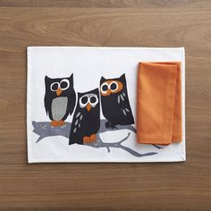 Owl trio is a hoot, with wide-eyed curiosity and whimsy.  Cotton placemat is coated with food-safe acrylic, making this a fun and easy-care option for the Halloween kids' table.  Soft, pre-washed Portuguese cotton napkin with hemmed borders is the essence of elegant simplicity. 100% cotton placemat with food-safe acrylic coatingSpot clean placemat100% pre-washed cotton napkinMachine wash napkin cold, tumble dry; warm iron as neededMade in India.