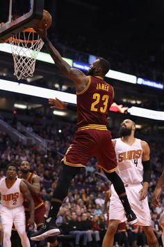 LeBron James Photos Photos - LeBron James #23 of the Cleveland Cavaliers lays up a shot during the first half of the NBA game against the Phoenix Suns at Talking Stick Resort Arena on January 8, 2017 in Phoenix, Arizona. NOTE TO USER: User expressly acknowledges and agrees that, by downloading and or using this photograph, User is consenting to the terms and conditions of the Getty Images License Agreement. - Cleveland Cavaliers v Phoenix Suns