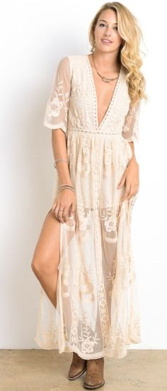 THIS DRESS FEATURES A DEEP V NECKLINE, FLORAL EMBROIDERY IN MUSTARD , THREE-QUARTER LENGTH SLEEVES, ENCLOSED ZIPPER AT BACK, SHEER SKIRT, PARTIALLY LINED RUNS TRUE TO SIZE. All Measurements are comple