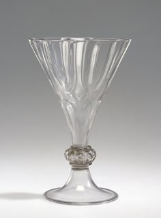 Goblet (Kelchpokal); Unknown maker, Façon de Venise, possibly the Glashütte of Wolfgang Vitl (Austrian, active 1534 - 1540), or of Sebastian Höchstetter (Austrian, active 1540 - 1569); 1535 - 1555; Free- and mold-blown colorless (purplish gray) glass with gilding; 18.9 x 12.4 cm (7 7/16 x 4 7/8 in.); 84.DK.542