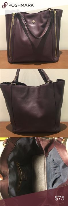 "Pour La Victoire Nouveau leather tote Plum In good condition. Glossy plum leather with gold tone hardware. Buckled straps with 8"" drop. Expandable zippered gussets down front. Hidden magnetic top closure.  Inside pockets one zip and two open. Pour la Victoire Bags Totes"