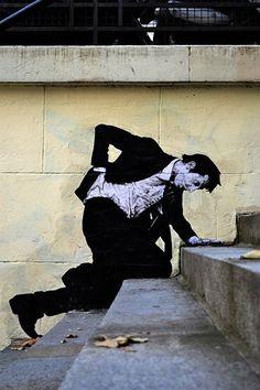 Street artist Charles Level wall graffiti