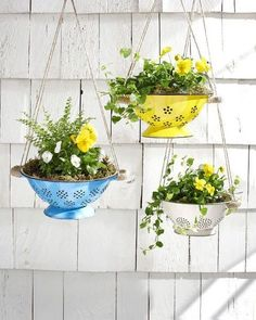 10 Incredibly Creative DIY Garden Planters Hang spring flowers in brightly colored colanders for an unexpected and truly unique way to update your porch. The post 10 Incredibly Creative DIY Garden Planters appeared first on Garden Easy. Diy Planters, Garden Planters, Planter Ideas, Hanging Planters Outdoor, Patio Plants, Plants Indoor, Balcony Garden, Flowers In Planters, Outdoor Plant Stands