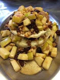 Warm Brie topped with Granny Smith Apples, Raisins and Walnuts in a Cinnamon Sugar Butter Glaze