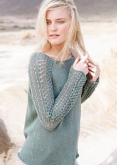The body of the sweater is knitted in the round in stocking stitch. The sleeves are knitted in the rund in a lace pattern, with a strip of stocking stitch underneath the arms in which all increases are inserted.