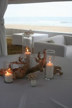 Driftwood and candle centerpieces. Very simple, but lovely. Half of the tables could look like this.