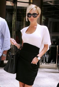 Pin for Later: Victoria Beckham's 45 Most Fabulous Moments in a Pair of Sunglasses Or a Breezy White Top and High-Waisted Skirt
