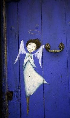 Angel painting on a vivid blue door. Prophetic art.