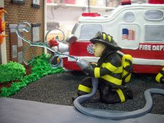 Fire Truck Cake 2 (tineypics) Tags: boss building cake truck fire smoke engine carlos hose burning bakery fireman firefighter fondant cakeboss
