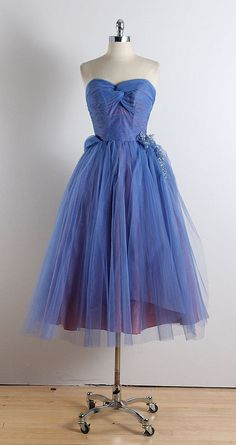 ➳ vintage 1950s dress  * blue tulle * purple acetate lining * sequin side accent * bodice stays * back sash * metal side zipper * by Rochelle Salon NY  condition | excellent  fits like xs/s  length 45 bodice 10 bust 34 waist 26  ➳ shop http://www.etsy.com/shop/millstreetvintage?ref=si_shop  ➳ shop policies http://www.etsy.com/shop/millstreetvintage/policy  twitter | MillStVintage facebook | millstreetvintage instagram | millstreetvintage...