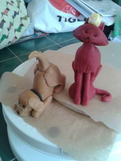 Sugarcraft cat and dog wedding cake toppers