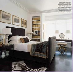 Add built-in bookshelves next to the bedroom window for a bookish room and cute window nook.