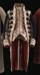 Livery Coat and Waistcoat  1810-1850; Britain; Wool broadcloth trimmed with wool livery lace, lined with wool and linen  Some suits of livery were highly elaborate in appearance, despite the relatively low status of the wearer. The suits were intended to proclaim the wealth of the employer, not the employee.