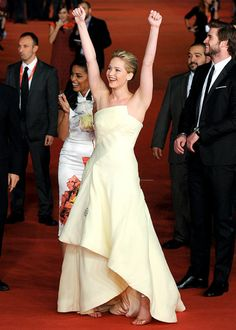 Jennifer Lawrence gave a cheery battle cry at the Rome Film Festival premiere of The Hunger Games: Catching Fire.