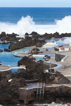 Portugal: These natural pools in Porto Moniz, Madeira are filled by tides from the Atlantic Ocean and surrounded by lava rocks. Visit Portugal, Spain And Portugal, Portugal Travel, Dream Vacations, Vacation Spots, Beautiful Islands, Beautiful Places, Places To Travel, Places To See