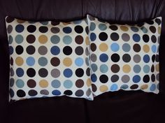 Brown, black, and blue pillows that would make our mismatched furniture look intentional..