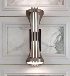 sconce and wall paneling by Blainey North