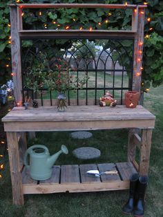 I like the idea of using old fence panels for the back of this potting table.