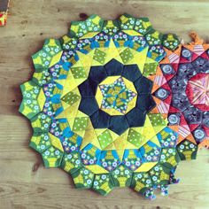 "Some ammmaaaaazing paper-pieced cogs by Mariko of Read More Good Books for her ""Passacaglia"" quilt. Wowee-kazowee!"
