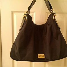 """Reduced**Gorgeous Kenneth Cole handbag/tote fabric and pvc with gold oversized lobster claw trim; really stands out; 1 outside zippered pocket; 1 inside zippered side pocket and 2 open side pockets; magnetic closure; black fabric inside; 18"""" wide x 13.5 tall Kenneth Cole Reaction Bags Totes"""