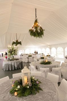 Winter wedding reception decor with a beautiful white draped tent and winter greenery {Arte De Vie}