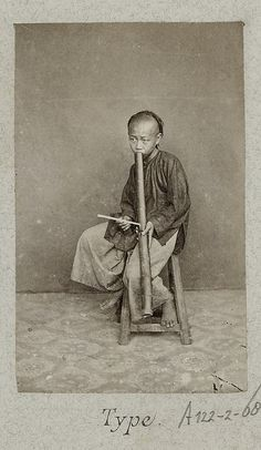 Portrait of Vietnamese boy with water pipe 1888