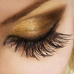 diy gold eyeshadow  How to:  Apply gold eyeshadow from the lash line to the crease, in the inner corner of the eye, and below the lower lash line.  Apply brown cream shadow to the middle of the lid, followed by black eyeshadow, blending out toward the outer corner of the eye.  Line the inner rims with a black liner, making sure to loop it around the inner corner as well.  Add two coats of mascara to top and bottom lashes.