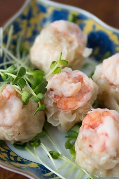 Shrimp Shumai: Steamed Chinese dumplings often served at dim sum, filled with a mixture of shrimp and squid, these shumai are juicy, flavorful and delicious. -