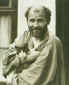 Gustav Klimt with his pet, Katze.
