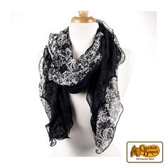 This stylish black and white ruffle scarf is the perfect gift for women on your gift list this year.     Answer fun questions and you could win in the Cracker Barrel Old Country Store Pick it to Win it Sweepstakes. Start 'picking' your answers at crackerbarrel.com/win (ends Jan 2, 2013).