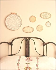 Doilies framed in embroidery hoops.
