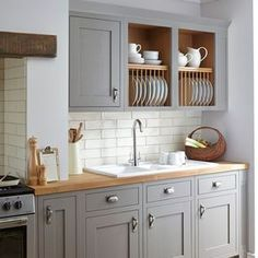I'm loving the colour combinations for Shaker style kitchens. Trending now are Shaker kitchens in white, black or grey hues that look absolutely gorgeous. The grey cabinets contrast beautifully with warm wood accents and countertops.