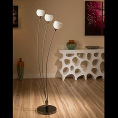Stunning tulip standard floor light with white glass ball shades.  A truly stunning item with 3 beautiful glass shades and heavy nickel chrome base.  Made by Europe's top lighting manufacturer, please do not confuse with cheap Asian copies.