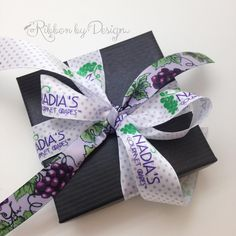 Custom ribbon is our specialty! We love this lavender polka dot ribbon with a grape design. This was done for a client who sells fancy decorated grapes. Such a pretty addition to a box of treats!