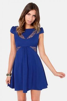 This woven royal blue dress makes you a sight-to-be-seen with its darted bodice and sultry sheer lace cutout at the decolletage, where cappe...
